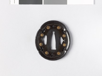Mokkō-shaped tsuba with chrysanthemums and inome, or heart-shapesfront