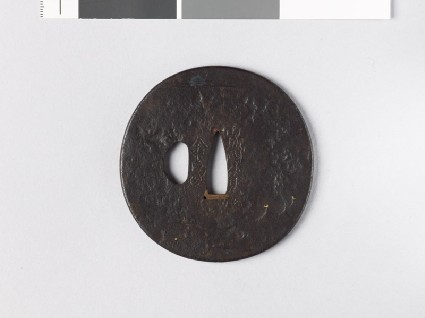 Round tsuba depicting a sea shore under cloudfront