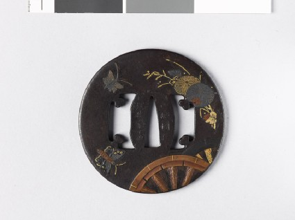 Tsuba with plants, butterflies, and chariot-wheelsfront
