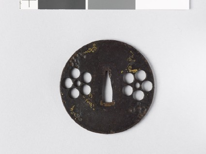 Round tsuba with heraldic mon and scrollsfront
