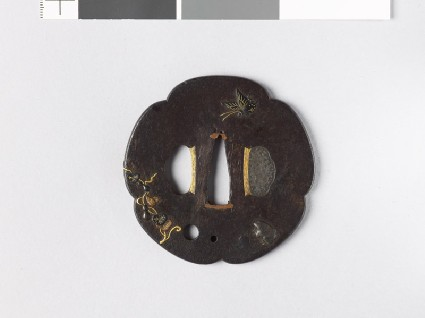 Lobed tsuba with butterflies, a toad, and a gourd-vinefront