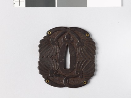 Tsuba with feather fans and gold eyeletsfront
