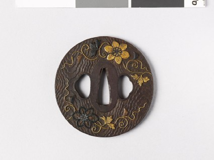 Lenticular tsuba with wood grain decoration and flowersfront