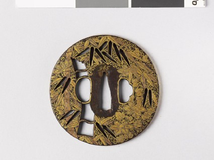 Round tsuba with bamboo and clematisfront
