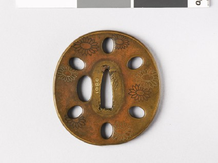 Tsuba with chrysanthemums and oval holesfront