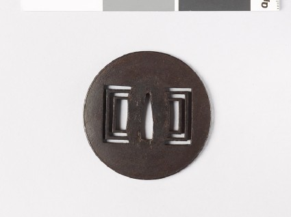 Tsuba with raised edge and oblong piercingsfront