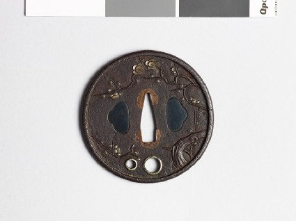 Tsuba with flowering plum treefront