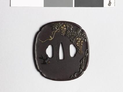 Mokkō-shaped tsuba with wisteria and a swallowfront