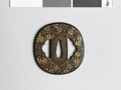 Tsuba with mitsudomoye, or three-comma shapesfront
