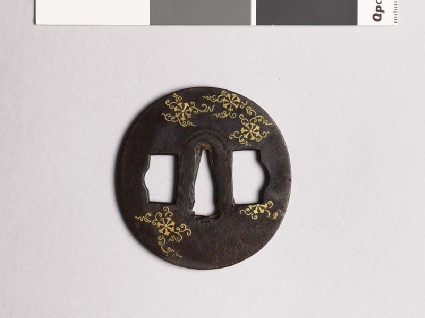 Tsuba with flowers and scrollsfront