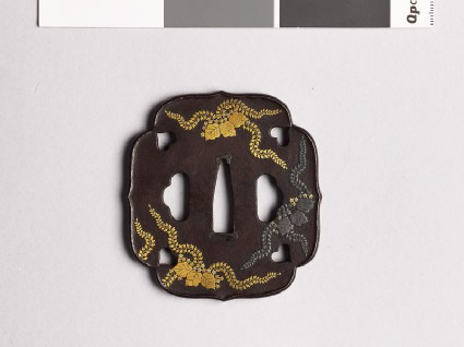 Aoi-shaped tsuba with kiri, or paulownia, leavesfront