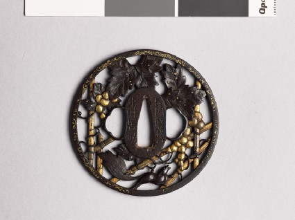 Round tsuba with grape vine and squirrelfront