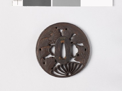 Tsuba with chrysanthemum and an aster flowerfront