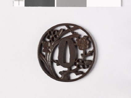 Round tsuba with plum blossom and narcissus flowersfront
