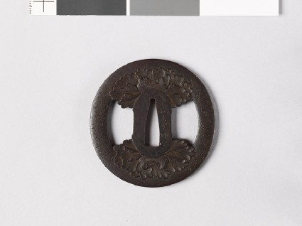Tsuba with peonies and karakusa, or scrolling plant patternfront