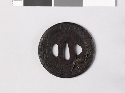 Round tsuba with clematis and cricketfront