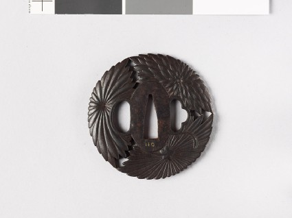 Round tsuba with three stylized chrysanthemumsfront