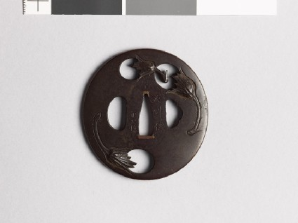 Lenticular tsuba with egg fruitsfront