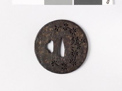Round tsuba with water plantfront