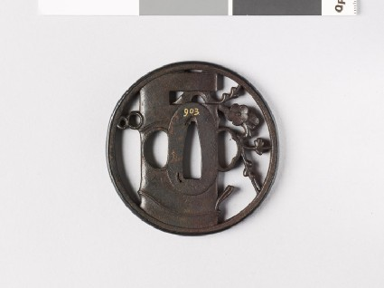 Round tsuba depicting a vase containing flowering plum twigfront