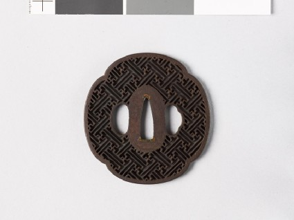 Mokkō-shaped tsuba with rinzu, or swastika-fret diaperfront