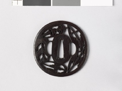 Tsuba with heraldic hawk feathers and ground bamboofront