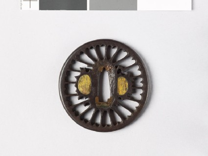Tsuba with chrysanthemoid floretsfront