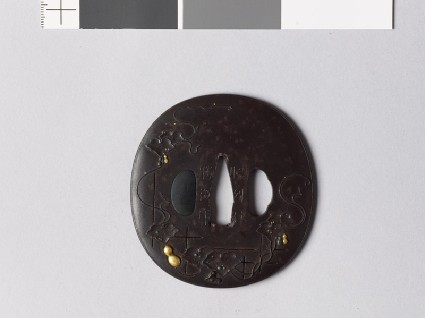 Lenticular tsuba with gourds on a vinefront