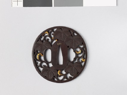 Tsuba with Cissus leaves and karakusa, or scrolling plant patternfront