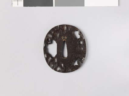 Tsuba with six holes of different sizesfront