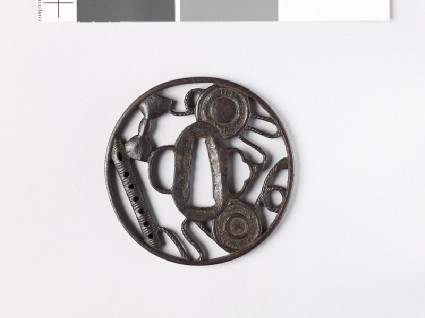 Round tsuba with six-holed flute and parts of a hand drumfront