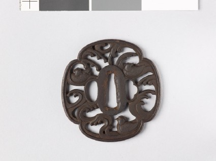 Mokkō-shaped tsuba with mandarin ducks and wavesfront