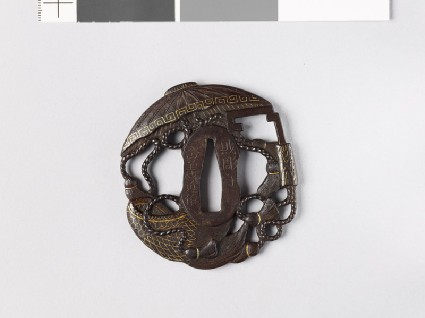 Tsuba in the form of takaramono, or precious things, including the hat and cloak of invisibility and the storehouse keyfront