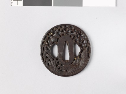 Tsuba with phoenix, flowers, and mon made from kiri, or paulownia leavesfront