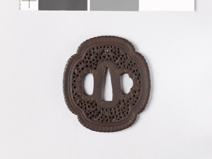 Mokkō-shaped tsuba with scrollwork and fishfront