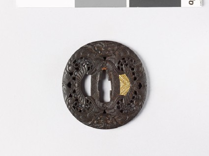 Tsuba with demon mask and scrollworkfront