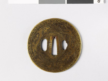 Round tsuba with dragons and Precious Objectsfront