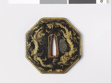 Octagonal tsuba with dragons and cloudsfront