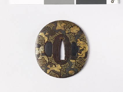 Lenticular tsuba with plants and animalsfront