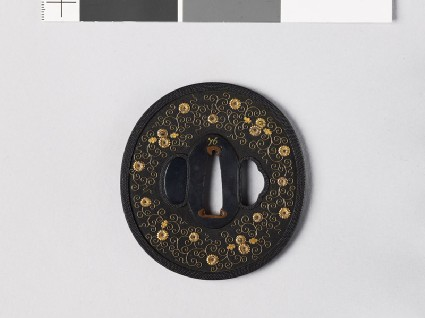 Tsuba with heraldic chrysanthemums and leavesfront
