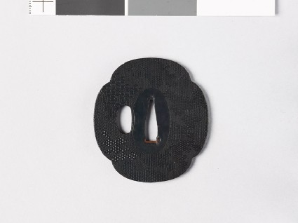 Mokkō-shaped tsuba with punched decorationfront