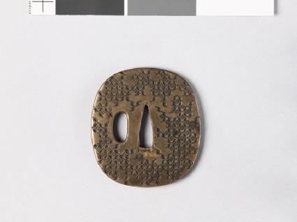 Tsuba with hanawachigai, or interlaced circles enclosing karahanafront