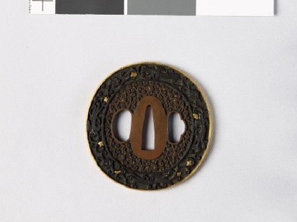 Tsuba with scrolls and fūchō, or birds or paradisefront