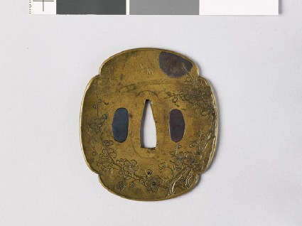 Mokkō-shaped tsuba with flowering plum treefront