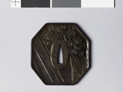 Octagonal tsuba with pine trees in driving rainfront