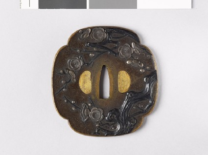 Mokkō-shaped tsuba with blossoming plum treefront