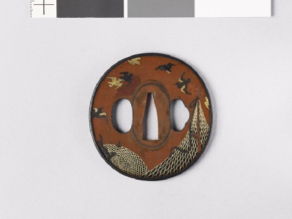 Tsuba depicting drying nets and birdsfront