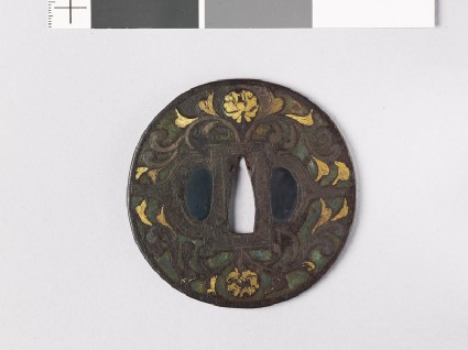 Round tsuba with flowers, foliage, and dragonsfront