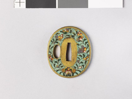 Tsuba with flowers and karakusa, or scrolling plant patternfront