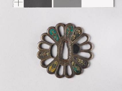 Tsuba in the form of a chrysanthemum monfront